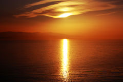 Seaside sunset scene in warm colors horizontal Royalty Free Stock Photo
