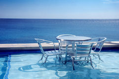Seaside table and chairs. Outdoor tables and chairs at a seaside resort in Jamaica stock photos