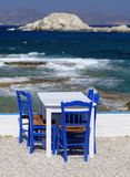 Seaside table and chairs Stock Photos