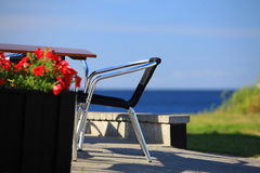 Seaside table and chairs in front of house Stock Image