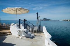 Seaside terrace. Seaside bar terrace in traditional Mediterranean color on Altea  bay, Costa Blanca, Alicante,  Spain Royalty Free Stock Image