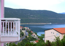 Seaside terrace view. Seats on pink house terrace with beautiful seaside view,Adriatic Sea ,Neum town Royalty Free Stock Photo