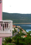 Seaside terrace view. Seats on pink house terrace with beautiful seaside view,Adriatic Sea ,Neum town Royalty Free Stock Photography