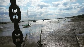 Seaside. Tide and boats Stock Images