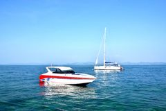 Seaside and tourist boat Royalty Free Stock Photos