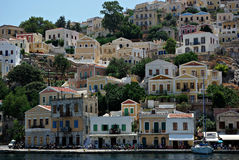 Seaside Town. Typical greece seaside town with many colorful houses built at hill over sea Royalty Free Stock Photography