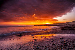 Seaside Under Cloudy Sky during Sunset Royalty Free Stock Image