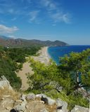 Seaside view in ancient Olympos. A composition with blue sky and still more blue sea: the photographer is standing on the hill (the rocks can be seen in the Stock Photo