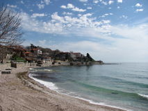 Seaside view Bulgaria. Waves blue sky clouds houses hollyday trip Stock Photos