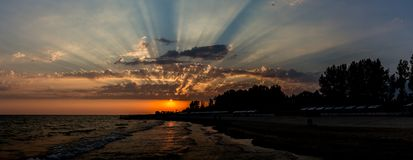 Seaside view. Fascinating seascape sunset. Fascinating clouds flashing by bright sunlight over the Black Sea seaside view in Lazurne, Kherson region stock photos