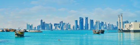 The seaside view, Doha, Qatar. The seaside view on futuristic skyscrapers of West Bay from the Corniche promenade, Doha, Qatar stock image