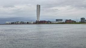 Seaside view over the turning torso. A seaside view over the turning torso and west harbor with cloudy sky stock image
