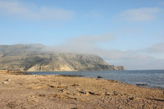 Seaside view - sand, mountain and sea Stock Photo
