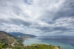 Seaside village on a hill. Taken in the hilltop town of Taormina, Sicily Stock Photos