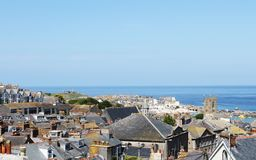 Seaside Village of St. Ives, Cornwall, UK. View over old town with typical houses in afternoon summer sunshine. Saint Ives, Cornwall, England, UK Stock Image