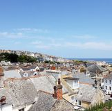 Seaside Village of St. Ives, Cornwall, UK. View over old town with typical houses in afternoon summer sunshine. Saint Ives, Cornwall, England, UK Royalty Free Stock Image