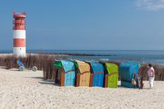 Seaside visitors in colorful beach chairs at German island Dune. Helgoland, Germany - May 20, 2017: Seaside visitors in colorful beach chairs at Dune, German stock photo
