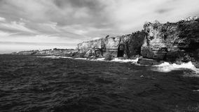 Seaside water And rocks. Portugal near Cascais, rocks And sea landscape blackandwhite photography Royalty Free Stock Images