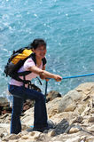 Seaside woman climber Stock Photo