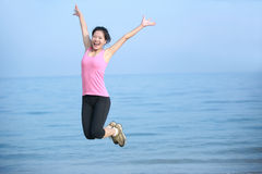 Seaside woman jumping Royalty Free Stock Photography