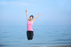 Seaside woman jumping Royalty Free Stock Image