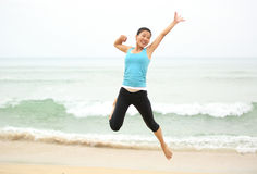 Seaside woman jumping Stock Photography