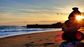 Seaside zen Moment rocks sun Sunlight. Sand And sea rocks sky afternoon sunset Royalty Free Stock Photos