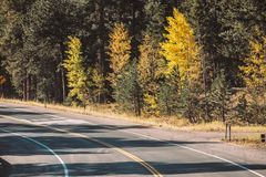 Highway at autumn in Colorado, USA. Season changing from autumn to winter. Highway in Colorado, USA Royalty Free Stock Image