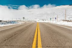 Season changing, first snow along highway. In Colorado, USA Royalty Free Stock Images