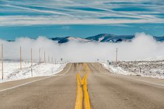 Season changing, first snow along highway. In Colorado, USA Royalty Free Stock Photos
