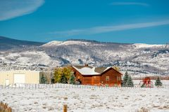 Season changing, first snow on roof. Rocky Mountains, Colorado, USA Stock Photography