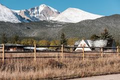 Season changing, first snow on roof. Rocky Mountains, Colorado, USA Royalty Free Stock Photo