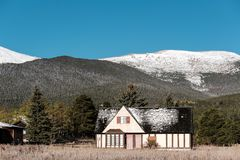Season changing, first snow on roof. Rocky Mountains, Colorado, USA Royalty Free Stock Image