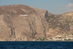 Season charter airplane landing in Santorini airport. During summer time stock photos