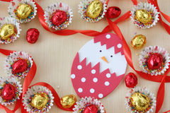 Season decoration: easter chocolate eggs frame with hand made hatched chicken in eggshell on wood background Stock Images