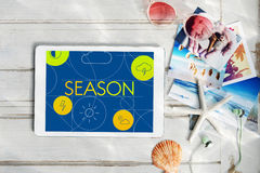 Season Forecast Temperature Cloud Graphic Concept. Digital tablet with season screen beach photos and accessories Stock Photos