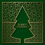 Season greetings card cover background with golden ornamental frame in Christmas tree shape Stock Photo