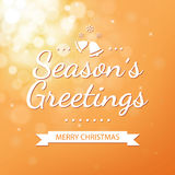 Season greetings with gold bokeh background for christ Royalty Free Stock Image