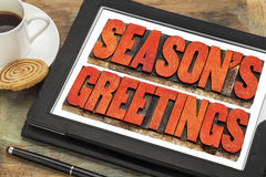 Season greetings in wood  type on tablet Stock Photos