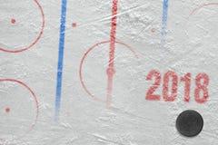 Hockey arena of the season 2018. The season of 2018, hockey puck and ice arena. Concept, hockey stock photos