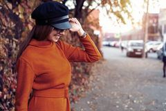 Season and people concept - Autumn portrait of happy girl. Outdoor beauty portrait woman, fashion model, pretty girl. Street style royalty free stock image