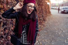 Season and people concept - Autumn portrait of happy girl. Outdoor beauty portrait woman, fashion model, pretty girl. Street style royalty free stock photo