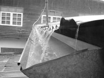 Raining. Rain water covered tin roofs and wood house Royalty Free Stock Images