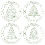 Season's greeting stamps with christmas trees vintage Stock Photos