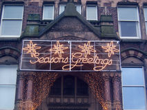 Season's greetings. Christmas lights greetings Royalty Free Stock Photos