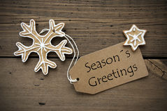 Season's Greetings on a Banner with Ginger Bread Cookies Stock Photography
