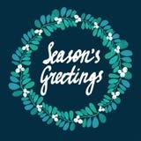 Season's Greetings calligraphy. Christmas floral frame. Christmas card. Stock Photos