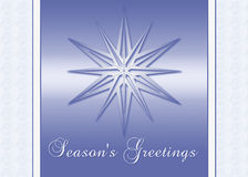Season's Greetings Card. An elegant blue greeting card with a gradient star Royalty Free Stock Images