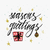 Season`s Greetings card. Hand lettering calligraphic inscription by brush for Christmas, New Year greeting card template. Snowflak Stock Photos