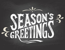 Season's greetings on chalkboard background Stock Images